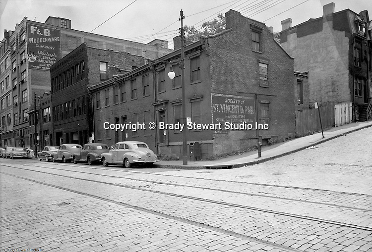 Pittsburgh PA:  View of Forbes Avenue business district between Magee and Stevenson streets in the uptown section of Pittsburgh near Duquesne University - 1950.  Assignment was for a developer trying to get some of the buildings condemned so he could get them at a good price for future development.