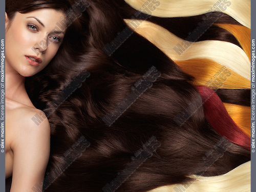 Beautiful woman with long brown hair and colorful hair extensions