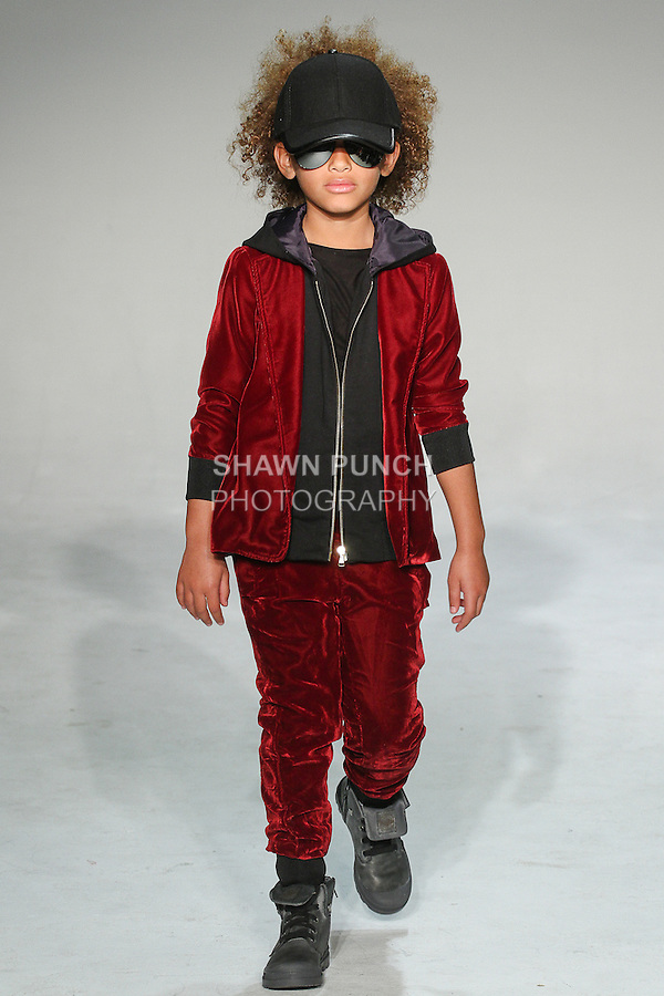 Model walks runway in an outfit from the Dillonger Fall Winter 2015 collection by Latoia Fitzgerald, during petitePARADE Fall 2015.