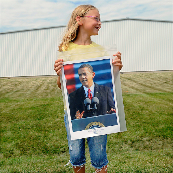 August 17, 2011: Atkinson, Illinois<br /> A girl watches President Barack Obama's motorcade pass by. It happened during the final day of Obama's swing through rural communities in the Midwest. &copy;Chris Fitzgerald / Candidate Photos