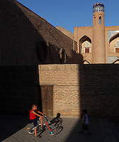 General view of children playing in Ichan Kala, the old city, Khiva, Uzbekistan, pictured on July 5, 2010, in the afternoon. Khiva, ancient and remote, is the most intact Silk Road city. Ichan Kala, its old town, was the first site in Uzbekistan to become a World Heritage Site(1991). Picture by Manuel Cohen.