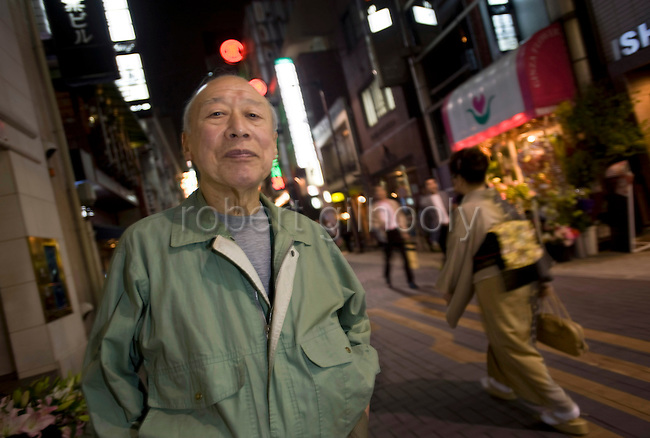 Porn star Shigeo Tokuda, 77, poses for a photo in in an entertainment district of central Tokyo, Japan on 17 Oct. 2011. Photograph: Robert Gilhooly