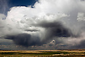 OR01292-00...OREGON - Storm clouds over the Malheur National Wildlife Refuge.