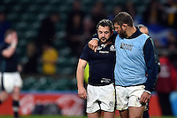 Ross Ford of Scotland commiserates team-mate Greig Laidlaw after the match. Rugby World Cup Quarter Final between Australia and Scotland on October 18, 2015 at Twickenham Stadium in London, England. Photo by: Patrick Khachfe / Onside Images