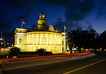Coral Gables City Hall, Florida at twilight with traffic rushing by.