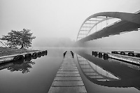 The water was calm on this foggy November morning at the 360 Bridge boat ramp. The bridge was reflected in the calm Colorado River, allowing for a clear black and white photograph.