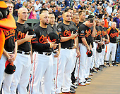 Baltimore Orioles players stand in tribute to former Oriole Mike Flanagan, who died earlier in the week, prior to their game against the New York Yankees at Oriole Park at Camden Yards in Baltimore, MD on Friday, August 26, 2011..Credit: Ron Sachs / CNP.(RESTRICTION: NO New York or New Jersey Newspapers or newspapers within a 75 mile radius of New York City)