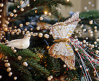 Pearl-covered branches, white sequin doves and butterflies adorn the Christmas tree