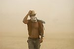Justin Collinson, a 26-year-old burner from Calif. weathers a dust-storm, Thursday afternoon, Aug. 30, 2007 during the annual Burning Man Festival on the Black Rock Desert near Gerlach, Nev. ..Photo by David Calvert/Nevada Sagebrush