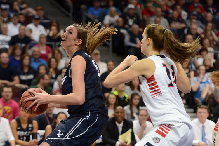 March 11, 2014; Las Vegas, NV, USA; Brigham Young Cougars center Jennifer Hamson (5) drives to the basket against Gonzaga Bulldogs forward Sunny Greinacher (14) during the second half of the WCC Basketball Championships at Orleans Arena.