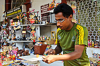 A man sells wooden toys hand-crafted locally on M.G. Road in Bangalore, India.