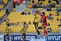 Jeremy Brockie and Osama Malik during the A League - Wellington Phoenix v Adelaide United, Wellington, New Zealand on Sunday 30 March 2014. <br /> Photo by Masanori Udagawa. <br /> www.photowellington.photoshelter.com.