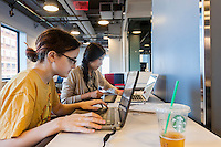 Zlata Barshteyn, left and Jenny Jiao Hsia, right, collaborate on developing computer games at a game jam at NYU-Poly in downtown Brooklyn in New York on Sunday, September 29, 2013. With women making up only 4 percent of game developers the Code Liberation project at NYU-Poly invited women coders of different skill levels to participate in a weekend long game jam to encourage more women to enter the tech fields. Over 20 women participated, working in teams to develop their games.  (© Richard B. Levine)