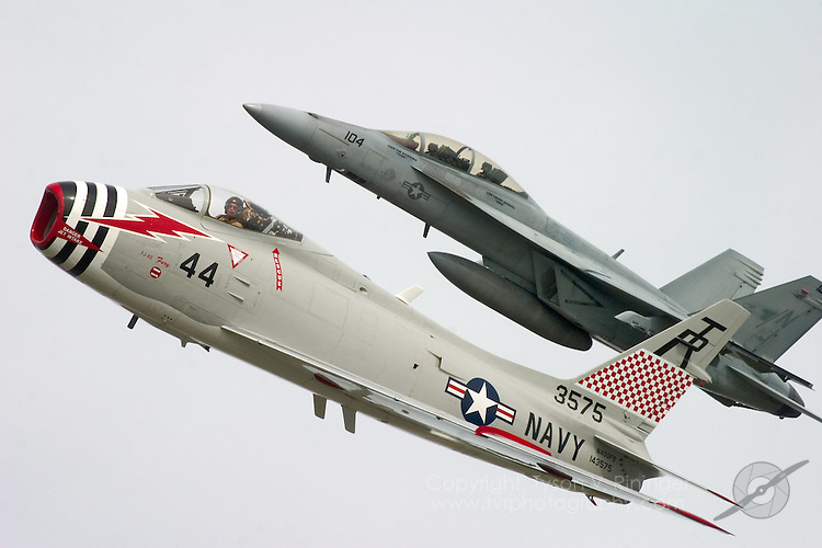 Formation training for the annual US Navy Tailhook Legacy Flight Program involves putting together aircraft from eras past with today's most advanced airframes. Here Dr. Richard 'Doc' Sugden flies his FJ-4B Fury in formation with an F/A-18F from VFA-122 Flying Eagles out of NAS Lemoore, California.