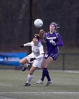 "Boston College defender Hannah Cerrone (11) intercepts pass to University of Washington forward McKenna Waitley (14). In overtime, Boston College defeated University of Washington, 1-0, in NCAA tournament ""Elite 8"" match at Newton Soccer Field, Newton, MA, on November 27, 2010."