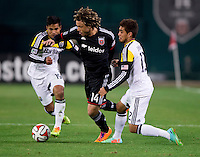 Nick DeLeon (14) of D.C. United holds off Hector Jimenez (12) of the Columbus Crew during a MLS game at RFK Stadium in Washington, DC.  D.C. United lost to the Columbus Crew, 3-0.