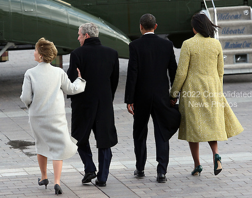 Washington, DC - January 20, 2009 -- Former United States President George W. Bush, his wife Laura, United States President Barack Obama and his wife Michelle walk out of the East Front of the Capitol after the inauguration of Obama as the 44th President of the United States of America on the West Front of the Capitol, Tuesday, January 20, 2009 in Washington, DC. Obama becomes the first African-American to be elected to the office of President in the history of the United States..Credit: John Moore / Pool via CNP