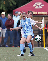 University of North Carolina forward Kealia Ohai (7) attempts to control the ball as Boston College defender Madison Meehan (14) pressures.  University of North Carolina (blue) defeated Boston College (white), 1-0, at Newton Campus Field, on October 13, 2013.