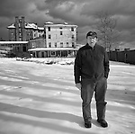 The Caretaker of the Buck Hill Falls Inn standing next to the hotel in winter