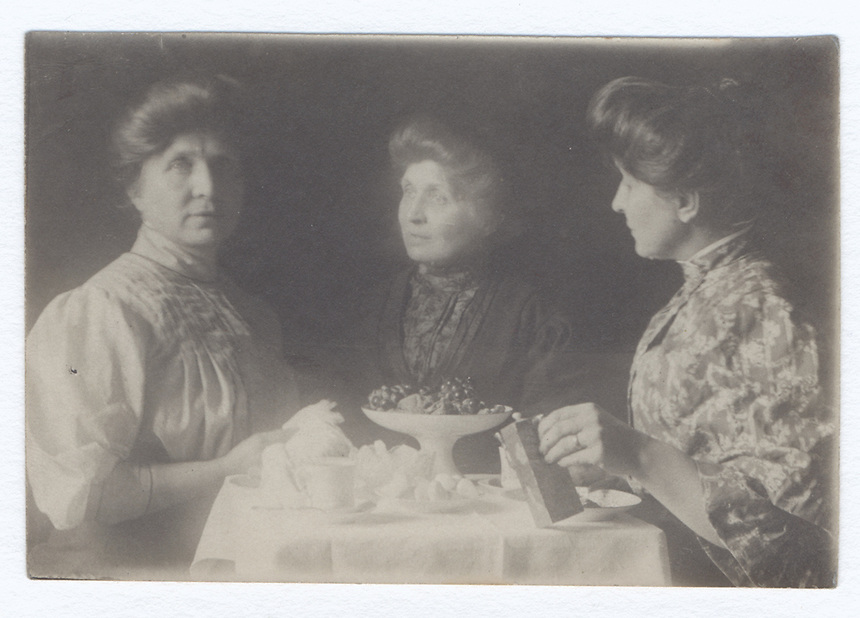19a. (6) <br /> <br /> see last part of above subject&mdash;triple of Sadie Crone with compote full of fruit<br /> <br /> 2 5/16  x  1 1/4  [sepia]<br /> <br /> figure in profile in flowery blouse, left hand holding a book-like object, right piece.