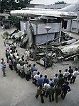 A MIG-21, whose pilot supposely shot down 16 American and Chinese warplanes, lords over fragments of enemy aircraft at the Military Museum in Hanoi, North Vietnam. (Jim Bryant Photo).....