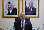 Palestinian Prime Minister Rami hamdallah heads the Palestinian cabinet meeting in the West Bank city of Ramallah on April 18, 2017. Photo by Prime Minister Office