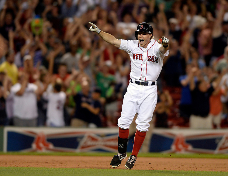 Boston Red Sox's Brock Holt celebrates his walk-off single against the Chicago White Sox at Fenway Park on Wednesday, July 09, 2014. Photo by Christopher Evans