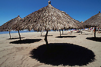 Palapas at Paraiso Radisson Resort beach on Banderas Bay. Puerto Vallarta, Mexico.