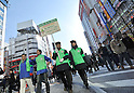 "January 23, 2011, Tokyo, Japan - Members of the governing board of ""Pedestrian Paradise"" patrol Tokyo's Akihabara district on Sunday, January 23, 2011. A record crowd of about 100,000 shoppers and tourists returned to Japan's electronics capital as the pedestrian-only shopping zone reopened for the first time in two years and seven months after the 2008 stabbing rampage that left seven dead and 10 others injured. (Photo by Natsuki Sakai/AFLO) [3615] -mis-"
