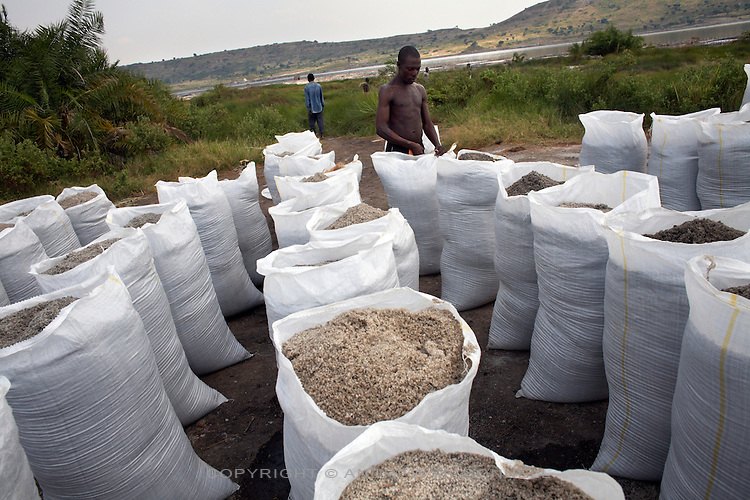 100 kg sacks of salt are lined up on shore in readiness to be loaded onto trucks, at Lake Katwe, Uganda. The transportation of salt increases its price dramatically and salt from Katwe is transported all over the region.