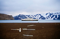 Deception Island, Antarctica, Jan. 5, 2007 - A view of the National Geographic Endeavor inside the caldera of Deception Island. An active volcano, it was last active in 1970. The continent of Antarctica is has no indigenous people, no permanent inhabitants and is not the sovereign territory of any nation. It does however have politics.  It is governed by an international agreement known as the Antarctic Treaty, which has been signed by 45 countries. The treaty stipulates that the continent can only be used for scientific research, which must be shared. Until, the mid 1980's the only visitors were scientists. By the mid 90's the number of tourists surpassed the number of scientists. In the 2005-06 season that number jumped to nearly 30,000. Currently there are few restrictions of the number of visitors, with most tour companies also supporting research. Lindblad/National Geographic Tour is one of those companies. The tourism finances the research arm of the company and allows for a meaningful opportunity to educate travelers about the many aspects of this valuable ecosystem.
