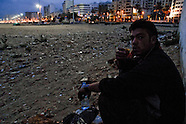 A young Moroccan immigrant eats bread that he begged from foreigners, Tanger, Morocco, 23 October 2006. Every day tens of Moroccan young men try to cross ilegally the Strait of Gibraltar. ?Harraga? (immigrants in Arabic) come to Tanger from all over Morocco. They try their good luck and hidden between the wheels of a truck they attempt to board on a ferry and get to Spain, eventually further to Europe. Considering the thorough checks at the port only few of them make it. Therefore they spend months living on a beach, in huts along the walls of the port, begging for food and waiting for the right night so as their dream about Europe came true.