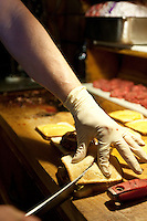Jeff Lassen, Louis' great grandson, prepares hamburgers at Louis' Lunch in New Haven, CT, USA, 26 May 2009.