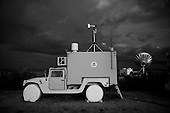 Huachuca City, Arizona<br /> USA<br /> August 23, 2007<br /> <br /> The support team for the Predator, fly the unmanned drown from this mobile vehicle on the ground. It is one of the high tech instruments being used by the US Border Patrol to monitor the US Mexican border at night. The unmanned plane flies virtually undetected at hundreds of feet and has heat-seeking cameras that can spot groups of smuggler crossing into the US in remote regions.