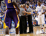 The referees discuss a foul that was called in the last few seconds of the of the men's basketball game vs. LSU at Rupp Arena, in Lexington, Ky., on Saturday, January 26, 2013. There were several fouls called during those last minutes that were a huge determiner of the game. Photo by Genevieve Adams  | Staff.