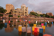 Lanterns float on the river in front of the A-Bomb Dome, in Hiroshima for 60th anniversary of bombing..Hiroshima, Japan, 6th August 2005.