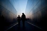 A couple walks by liberty state park in New Jersey, April 25, 2013. by Eduardo Munoz / VIEWpress
