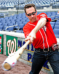 6 June 2010: Violinist Glenn Donnellan, a musician with the National Symphony Orchestra, swings his custom-made Louisville Slugger electric violin-bat prior to a game between the Washington Nationals and the Cincinnati Reds at Nationals Park in Washington, DC. The Reds edged out the Nationals 5-4 in a ten inning game. Mandatory Credit: Ed Wolfstein Photo