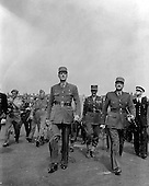 Paris, France - August 26, 1944 -- General Charles De Gaulle, leader of the Free French, heads a victory parade through the streets of Paris, France, culminating with a visit to the grave of the French Unknown Soldier where he placed a wreath on August 26, 1944.  To the right is General Koenig, center, to the rear, is General Le Clerc..Credit: U.S. Army via CNP