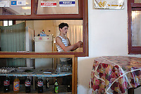 A young man working in a cafe in Batumi..