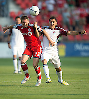 18 July 2012: Toronto FC midfielder Terry Dunfield #23 and Colorado Rapids midfielder Martin Rivero #10 in action during an MLS game between the Colorado Rapids and Toronto FC at BMO Field in Toronto..