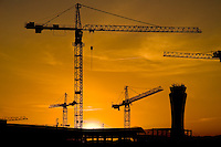 A tower crane seen on a construction site during sunset in Malaga, Spain, 18 May 2007. The construction boom in coastal areas of Andalucia was driven by demand for holiday or retirement homes, often for sun-seeking Europeans from the UK, Finland or Sweden, and by the strong immigration, which provided a cheap workforce.