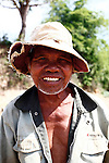 A Bahnar man smiles for a photograph near the Central Highlands town of Kon Tum, Vietnam. The Bahnar are one of more than two dozen hill tribes formerly known in the West as Montagnards, but who are now called the Dega. April 14, 2012.
