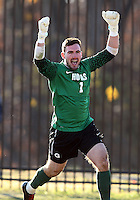 WASHINGTON, DC - NOVEMBER 25, 2012: Tomas Gomez (1) of Georgetown University celebrates after stopping a shot in the penalty kick phase of the game to give Georgetown the win over Syracuse University during an NCAA championship third round match at North Kehoe field, in Georgetown, Washington DC on November 25. Georgetown won 2-1 after overtime and penalty kicks.