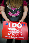 SACRAMENTO - JUNE 17:  A same-sex marriage supporter holds a sign before a press conference celebrating the one-year anniversary of a California Supreme Court ruling allowing same-sex marriages in Sacramento, California June 17, 2009. (Photo by Max Whittaker/Getty Images)
