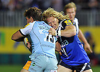 Tom Biggs tackles Dominic Waldouck. Aviva Premiership match, between Bath Rugby and Northampton Saints on September 14, 2012 at the Recreation Ground in Bath, England. Photo by: Patrick Khachfe / Onside Images