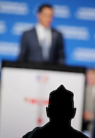 A silhouetted veteran listens to presidential candidate Mitt Romney speak at the Veterans of Foreign Wars national convention, Tuesday, Aug. 30, 2011, in San Antonio. (Darren Abate/pressphotointl.com)