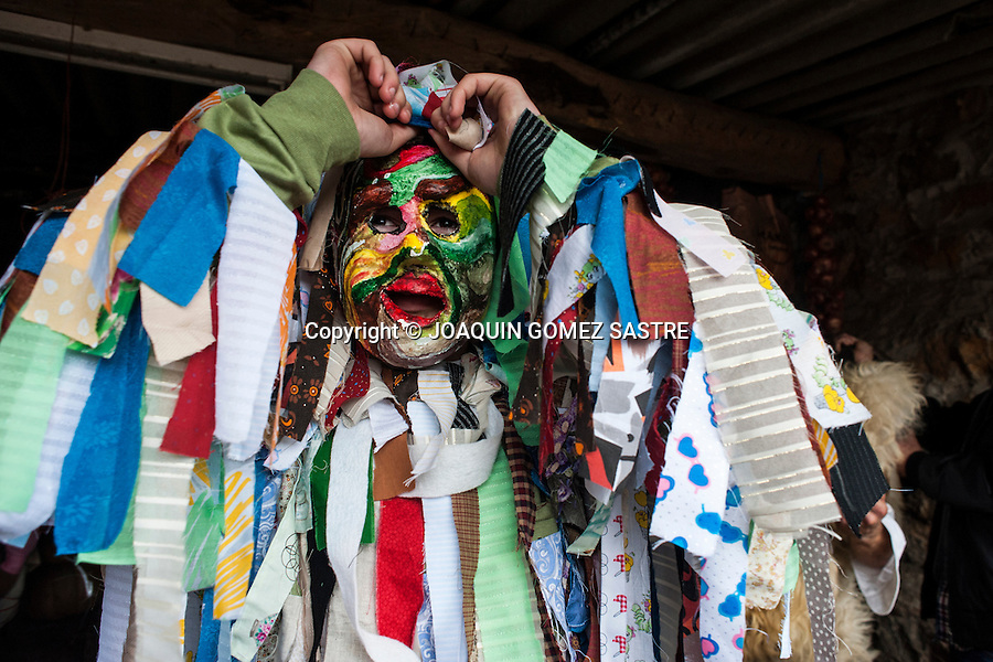 one of the trapajones (characters whose costumes are made with rags) places his mask during the Carnival of La Vijanera in Silio