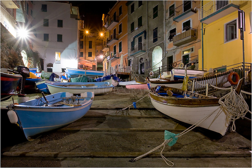 Late at night, the tiny harbor in the Cinque Terre village of Riomaggiore holds a few fishing boats while the town sleeps.