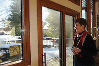 NWA Democrat-Gazette/FLIP PUTTHOFF <br /> Large windows, and lots of them, let the sun shine in   Wednesday Feb. 18 2015    at Kathy Trotter's home on Beaver Lake.